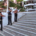Mariachis in front of beach copy